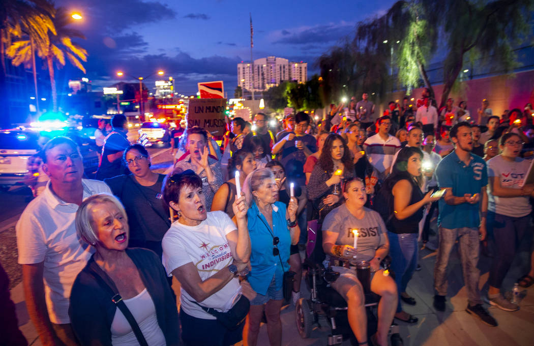 Advocates, activists and impacted persons hold lit candles and yell protest chants during Light ...