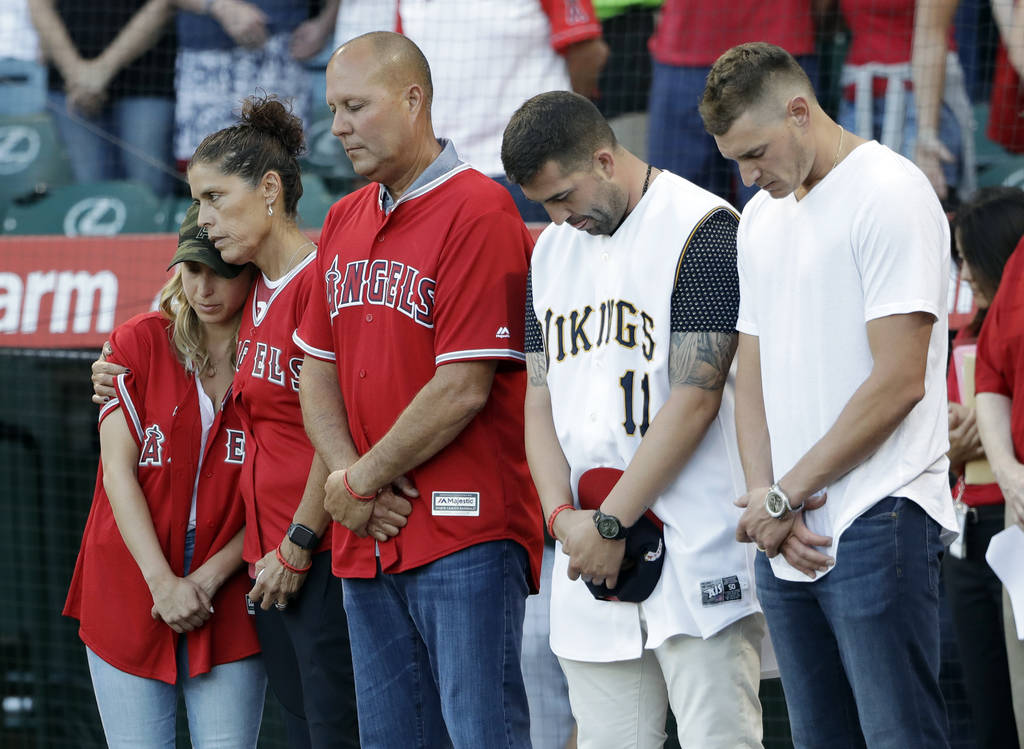 Members of Tyler Skaggs' family, including wife, Carli, left; mother, Debbie, second from left; ...