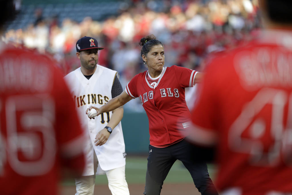 The late Los Angeles Angels pitcher Tyler Skaggs' mother, Debbie, center in red, throws the gam ...