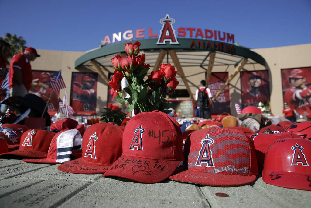 A makeshift shrine in honor of Los Angeles Angels pitcher Tyler Skaggs stands outside Angel Sta ...