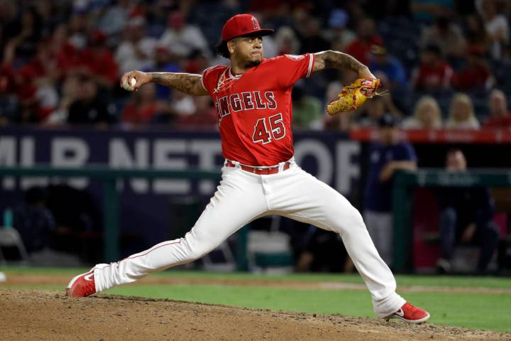 Los Angeles Angels relief pitcher Felix Pena throws to a Seattle Mariners batter during the six ...