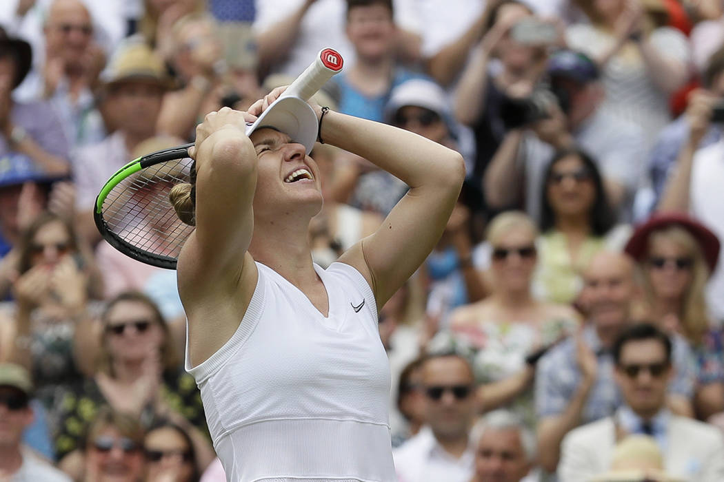 Romania's Simona Halep celebrates after defeating United States' Serena Williams during the wom ...