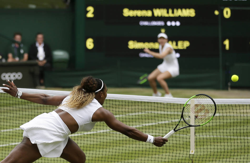 United States' Serena Williams returns the ball to Romania's Simona Halep, background, during t ...