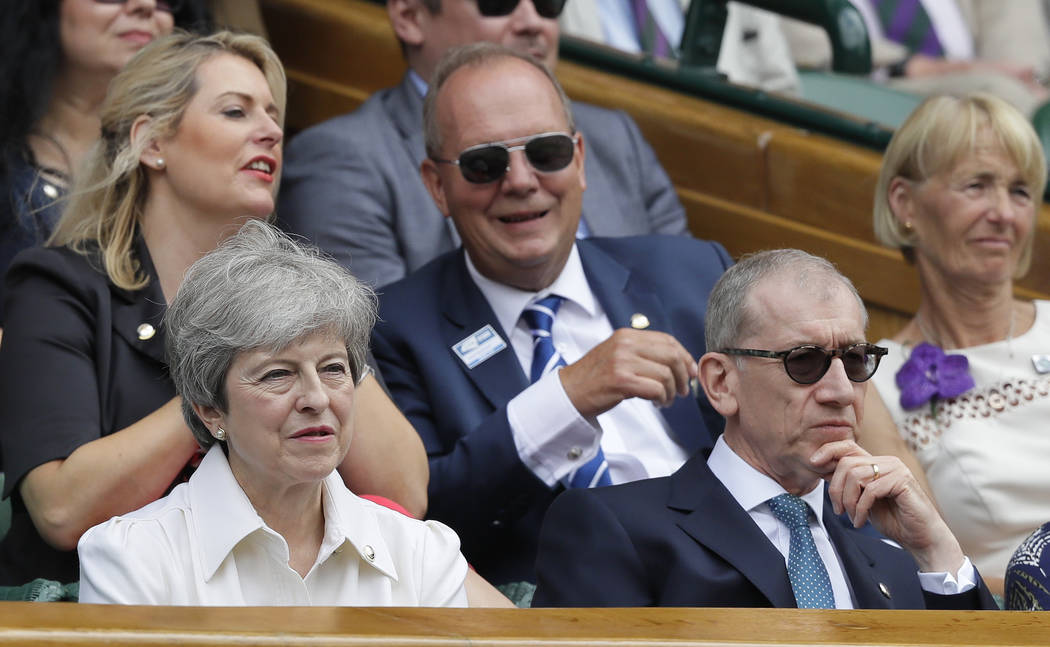 British Prime Minister Theresa May and her husband Philip sit in the Royal Box on Centre Court ...