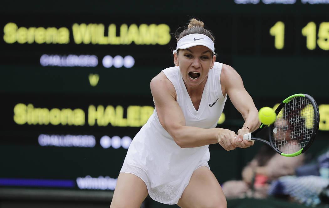 Romania's Simona Halep returns the ball to United States' Serena Williams during the women's si ...
