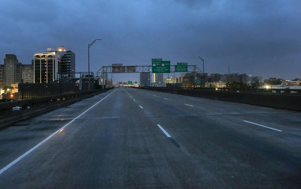 The I-10 in New Orleans is nearly empty of traffic as the eye of Tropical Storm Barry nears the ...