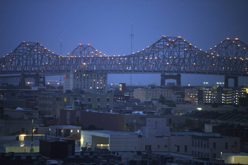 Clouds are seen over the Crescent City Connection bridge at dawn as Tropical Storm Barry approa ...