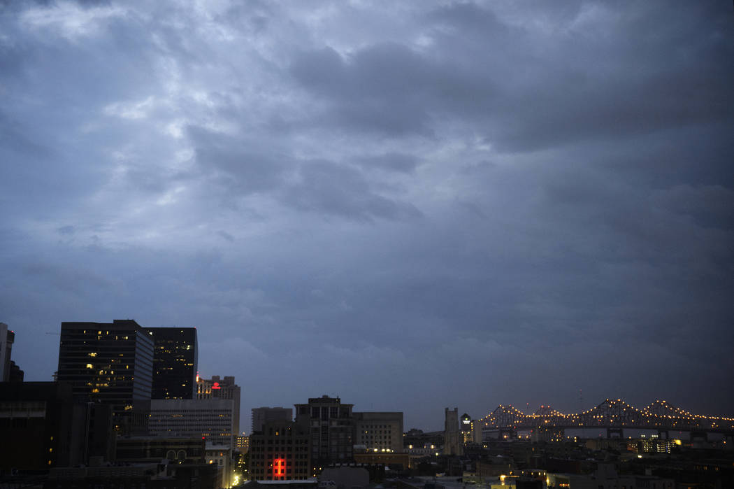 Clouds are seen over the Central Business District at dawn as Tropical Storm Barry approaches i ...