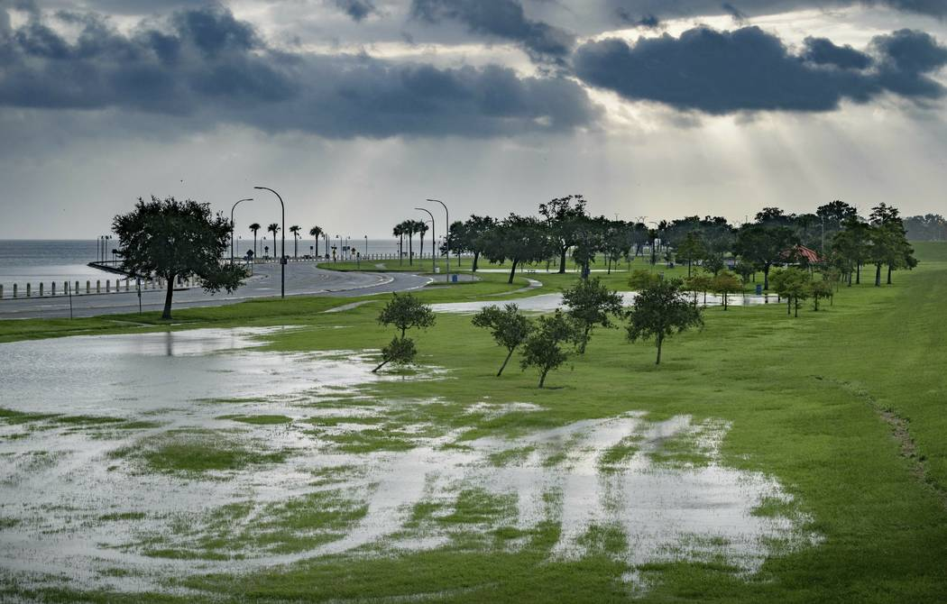 The sky is cloudy as over Lake Pontchartrain on Lakeshore Drive as little flooding is reported ...