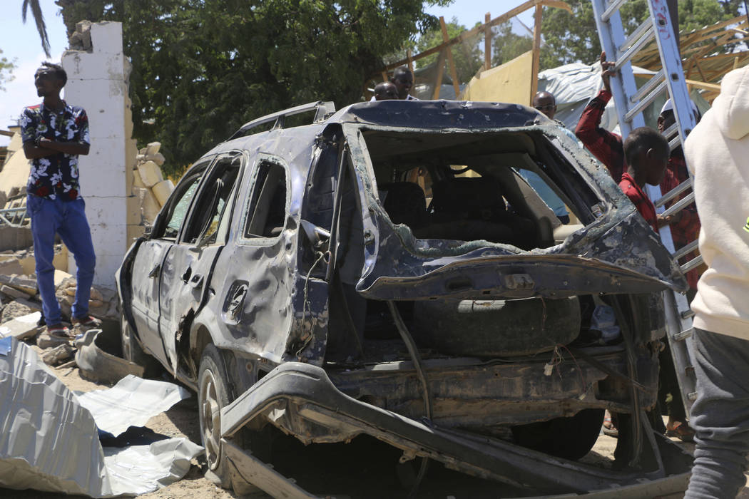 A view of a car destroyed during an attack at the Asasey Hotel, in Kismayo, Somalia, Saturday J ...