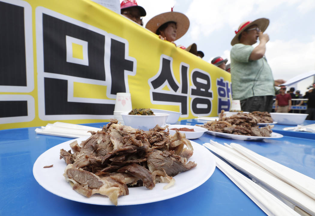 Members of the Korean Dog Meat Association stage a rally to support eating dog meat in front of ...