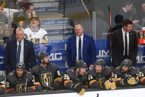 Golden Knights head coach Gerard Gallant, in blue, looks on during the third period of an NHL h ...