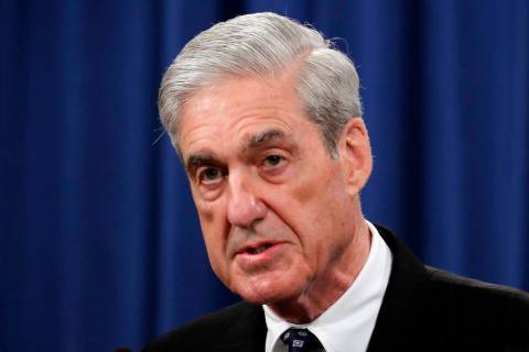 FILE - In this May 29, 2019, file photo, Special counsel Robert Mueller speaks at the Departmen ...
