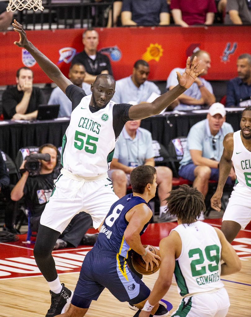 Boston Celtics center Tacko Fall defends the lane from Memphis Grizzlies guard Dusty Hannahs fo ...