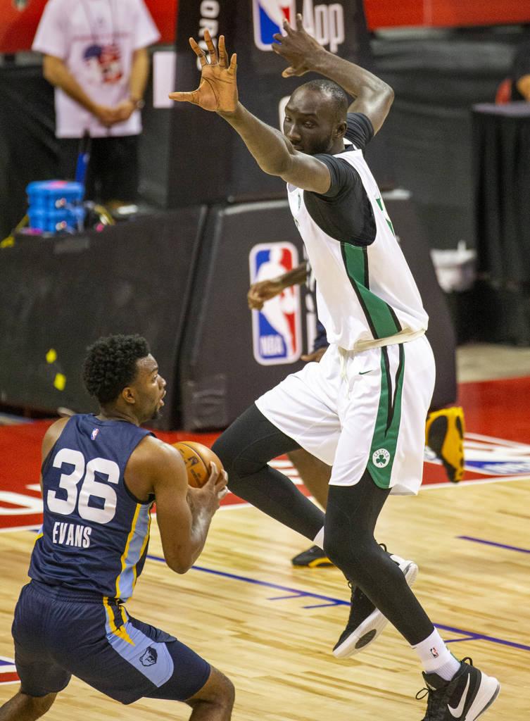 Boston Celtics center Tacko Fall defends a possible shot by Memphis Grizzlies guard Keenan Evan ...