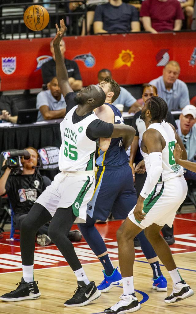 Boston Celtics center Tacko Fall, left, battles for a rebound over Memphis Grizzlies center Be ...