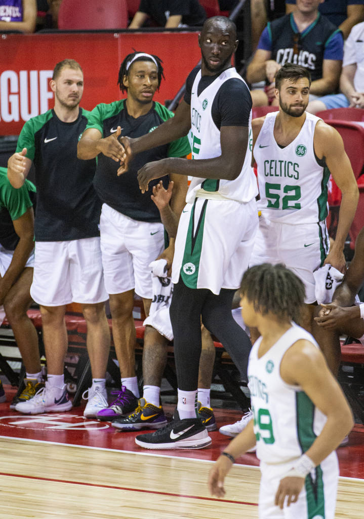 Boston Celtics center Tacko Fall, center, is congratulated by teammates after good play versus ...