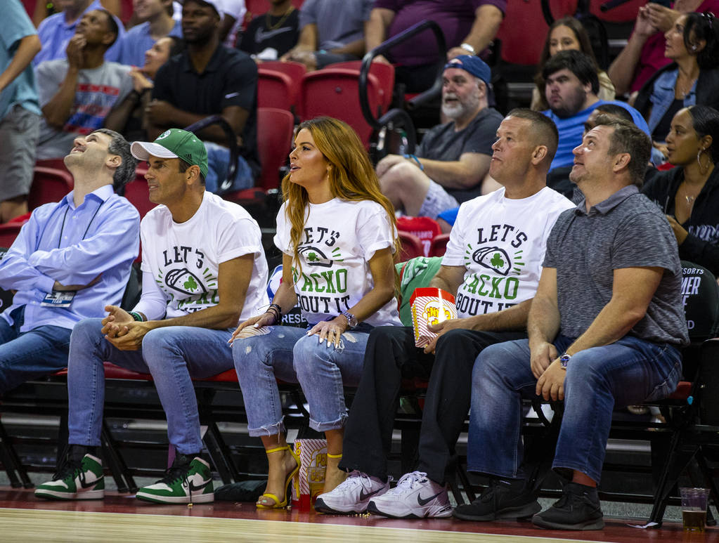 Fans of Boston Celtics center Tacko Fall wear t-shirts in his honor while watching them face th ...