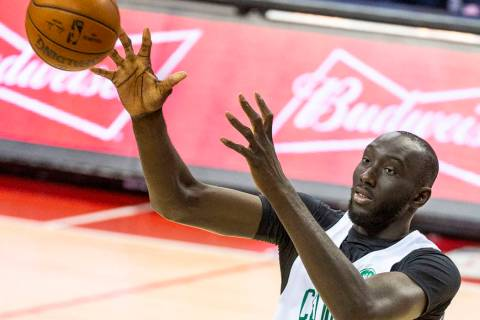 Boston Celtics center Tacko Fall looks in a rebound over the Memphis Grizzlies during the secon ...