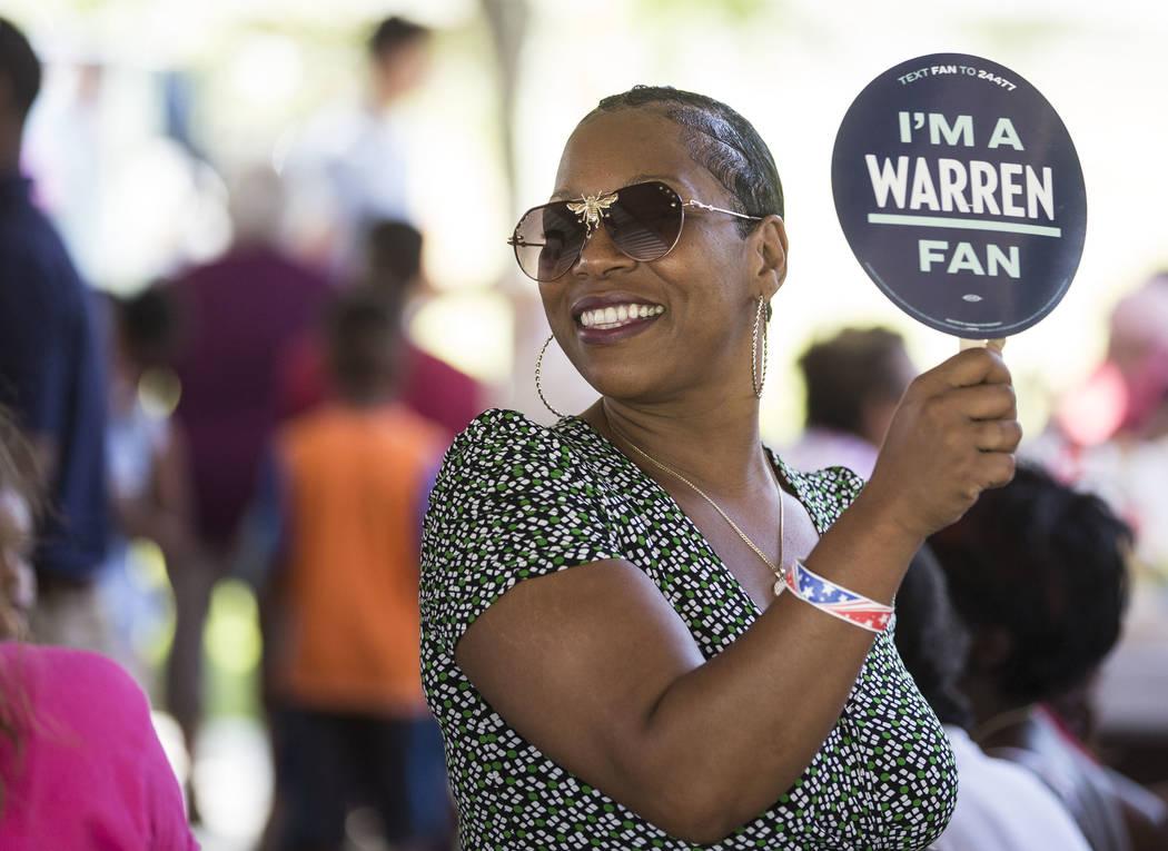 Lesha Lucas holds a sign for democratic presidential candidate Sen. Elizabeth Warren, D-Mass., ...