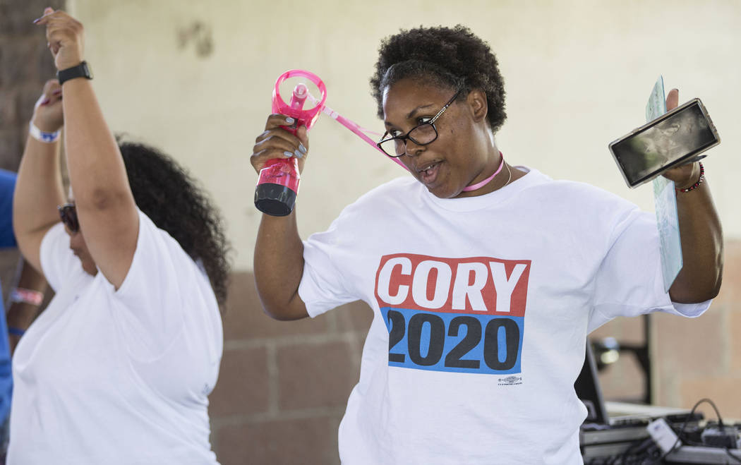ShaRhonda Ramos, right, an organizer for democratic presidential candidate Sen. Cory Booker, D- ...