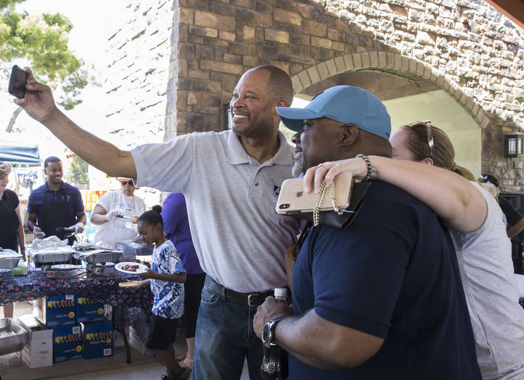 Nevada Attorney General Aaron Ford, left, takes selfies with guests during the 5th Annual Commu ...