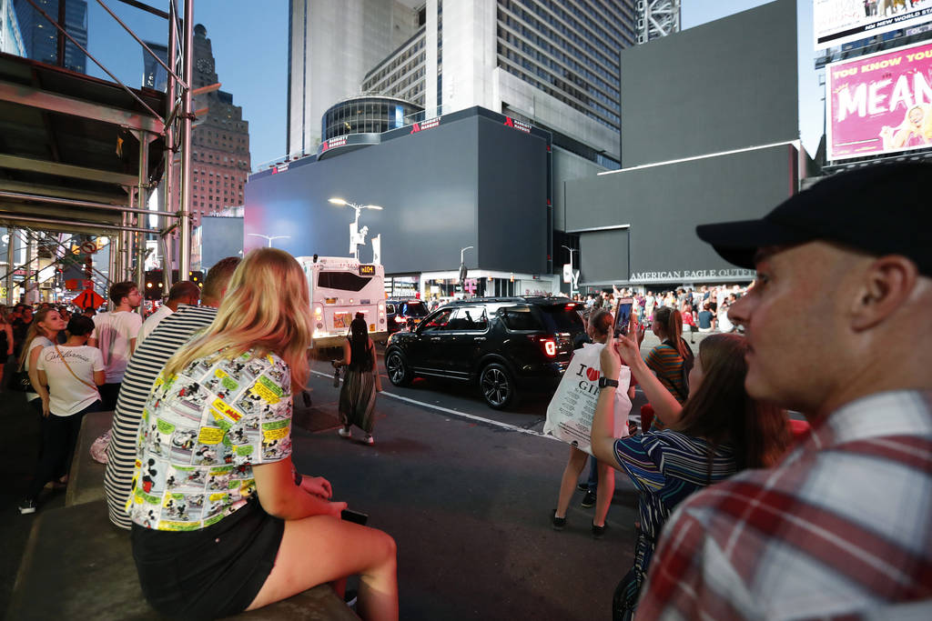 Screens in Times Square are black during a widespread power outage, Saturday, July 13, 2019, in ...