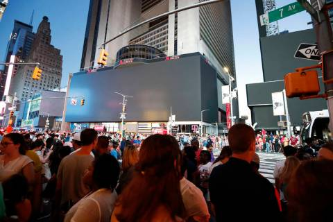 Screens in Time Square are black during a widespread power outage, Saturday, July 13, 2019, in ...