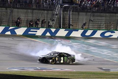 Kurt Busch does a burnout following his victory in the NASCAR Cup Series auto race at Kentucky ...
