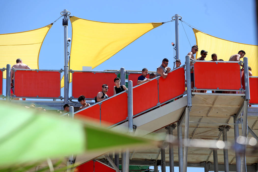 Guests wait in line for the Wild Surf slide at Cowabunga Bay water park in Henderson, Sunday, J ...