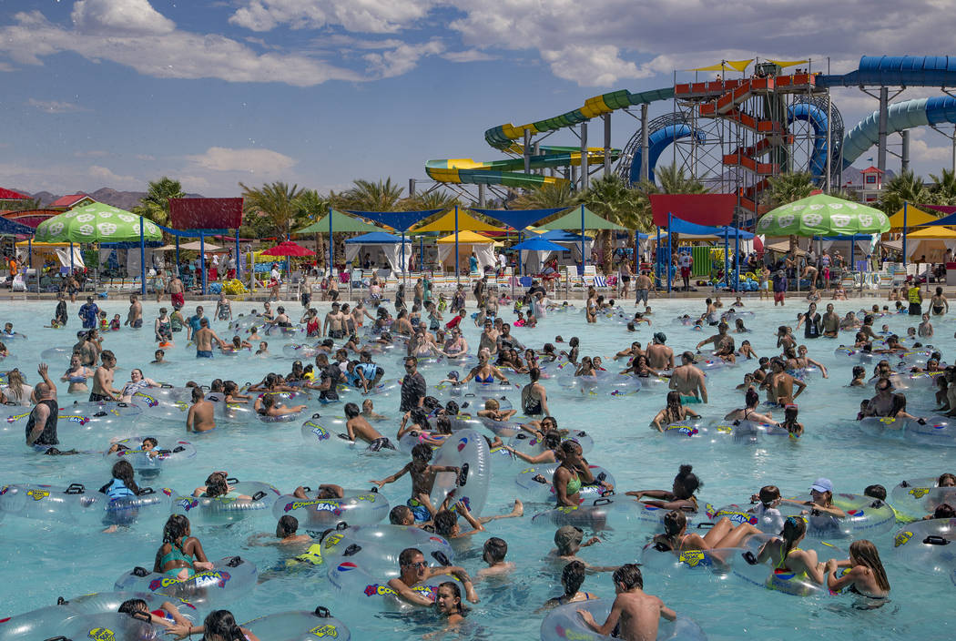 Revelers enjoy the Surf-A-Rama Wave Pool at Cowabunga Bay water park in Henderson, Sunday, July ...