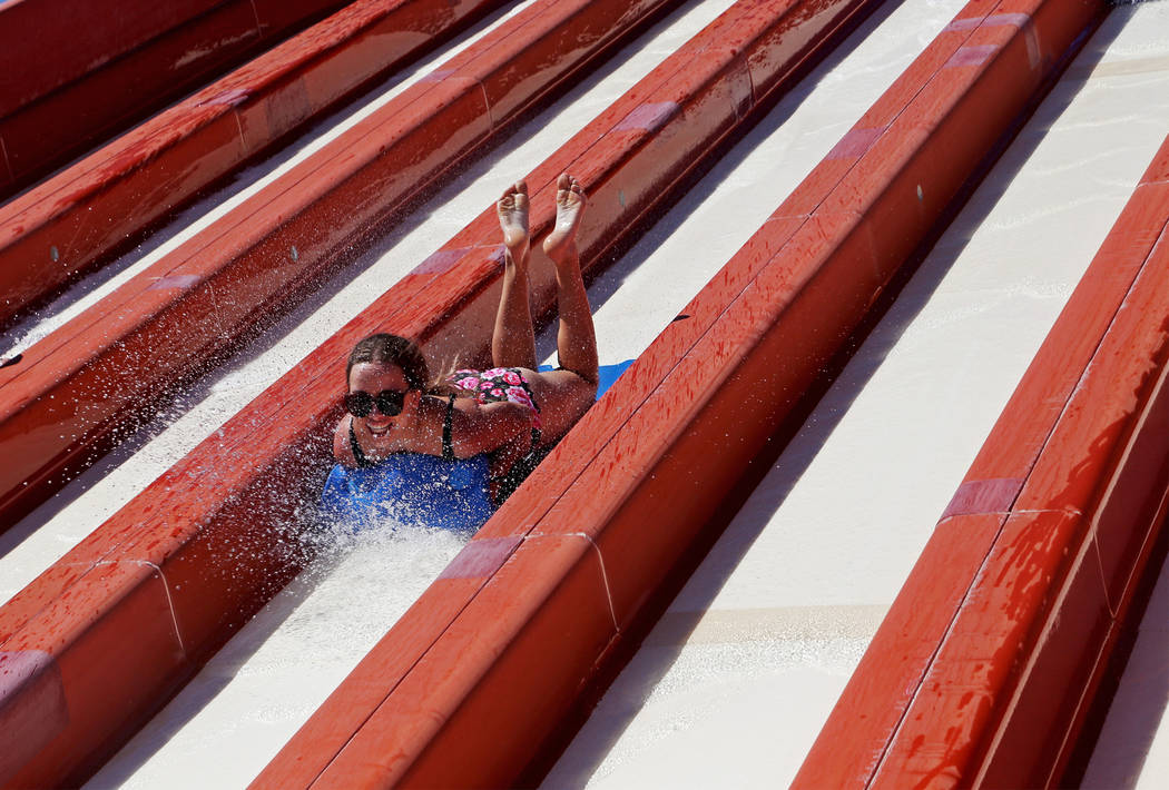 A guest enjoys the Surfing' USA slide at Cowabunga Bay water park in Henderson, Sunday, July 14 ...