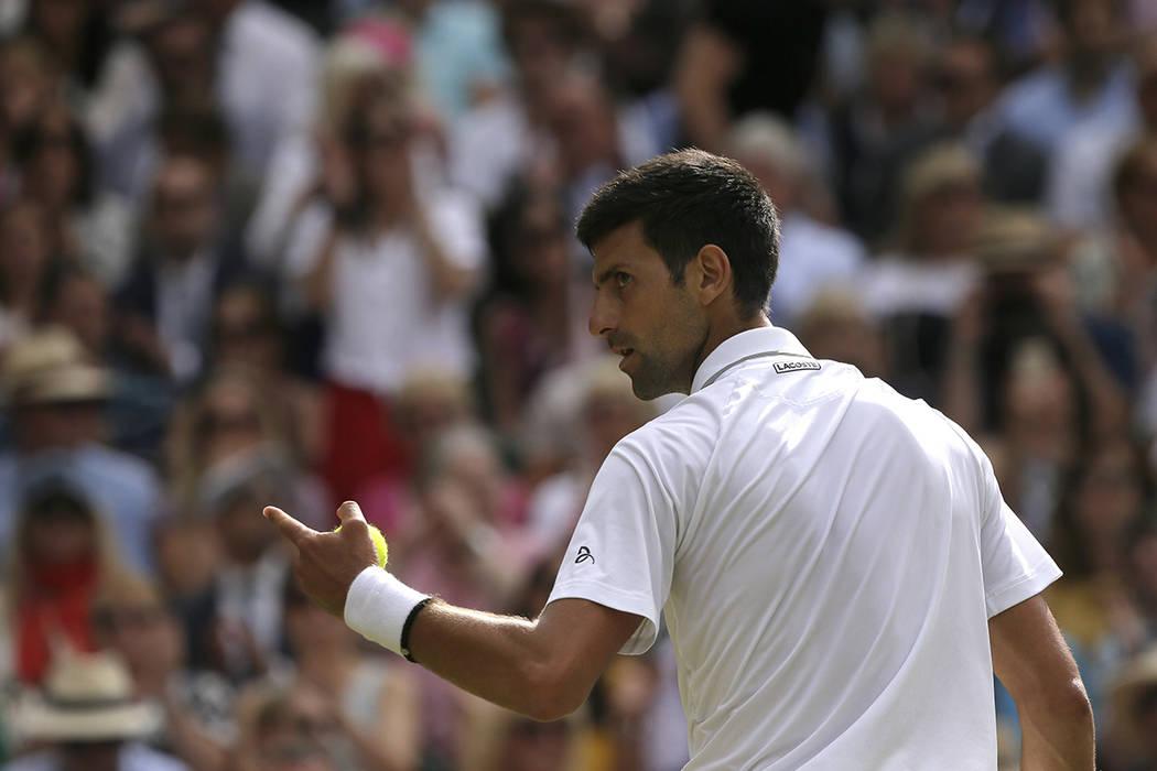 Serbia's Novak Djokovic celebrates winning a point against Switzerland's Roger Federer during t ...