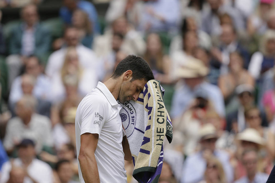 Serbia's Novak Djokovic is dejected after losing a point to Switzerland's Roger Federer during ...