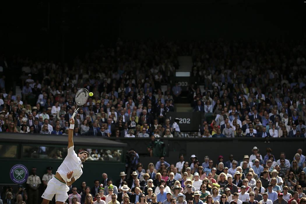 Serbia's Novak Djokovic serves to Switzerland's Roger Federer during the men's singles final ma ...