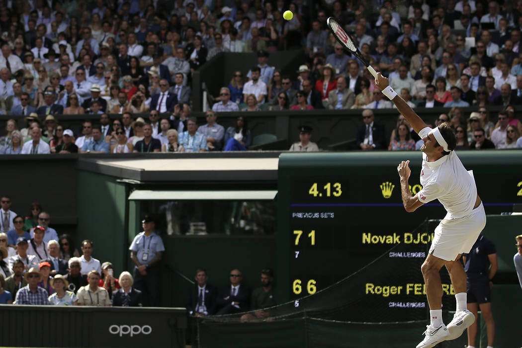 Switzerland's Roger Federer serves to Serbia's Novak Djokovic during the men's singles final ma ...