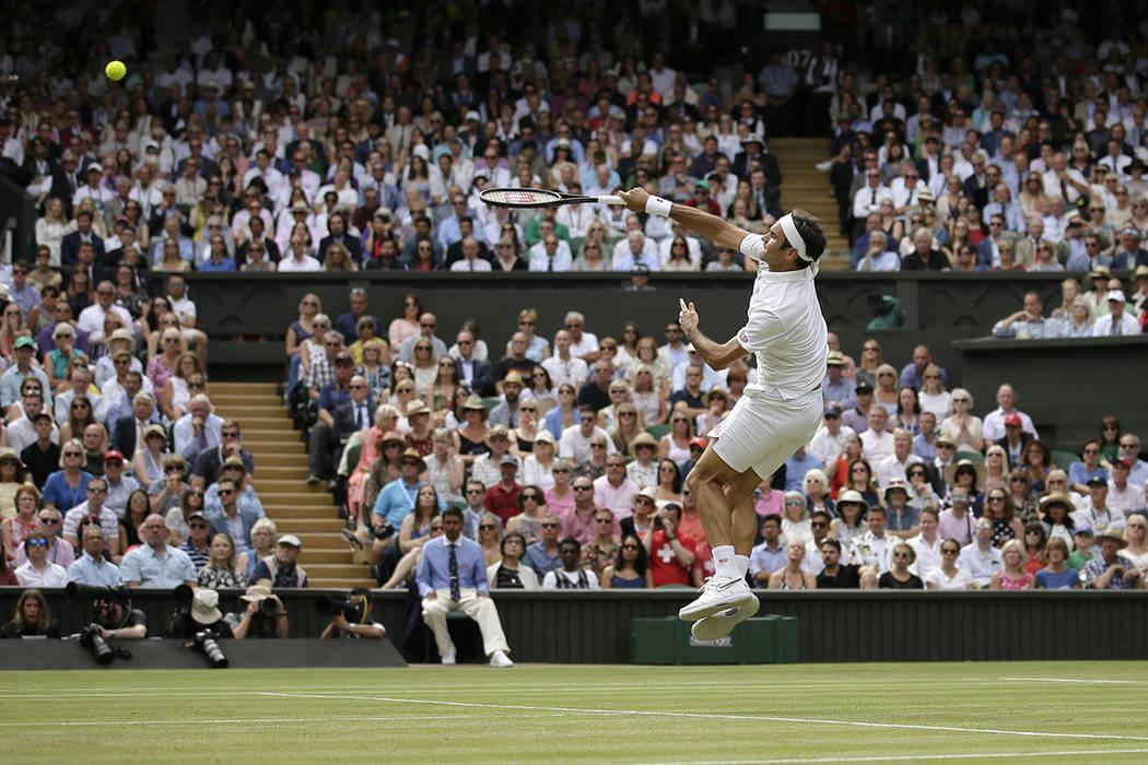 Switzerland's Roger Federer returns the ball to Serbia's Novak Djokovic during the men's single ...