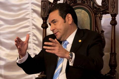 FILE - In this Jan. 10, 2019 file photo, Guatemalan President Jimmy Morales talks with Canada's ...
