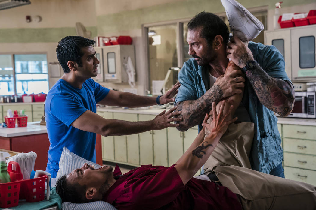 This image released by 20th Century Fox shows Dave Bautista, right, and Kumail Nanjiani, standi ...
