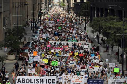 Thousands of people, including immigrants and their supporters, rally against President Trump's ...