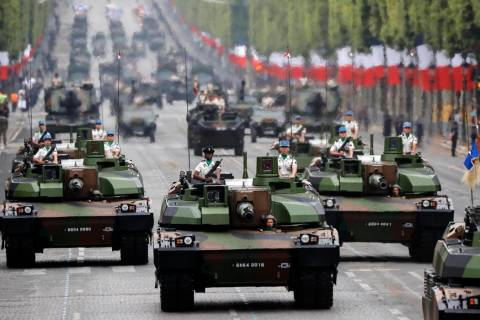 Tanks rolling on the Champs-Elysees avenue during the Bastille Day parade in Paris, France, Sun ...