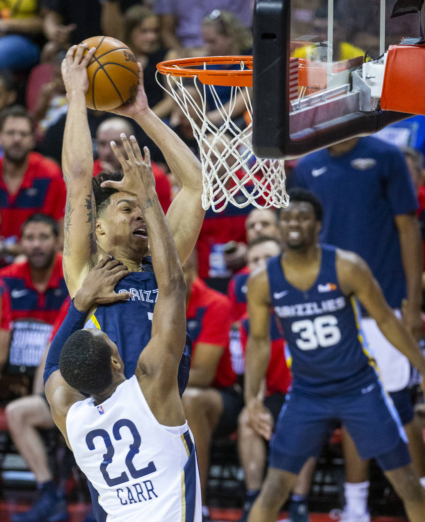 Memphis Grizzlies forward Brandon Clarke, left, goes unstrung to the basket over New Orleans Pe ...