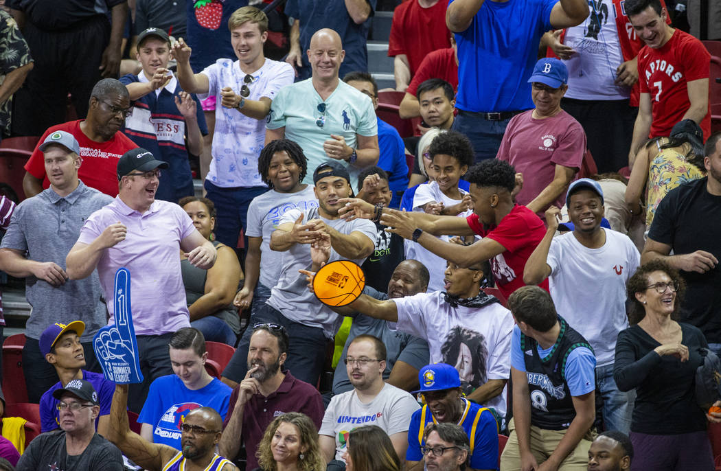 Fans yells for their teams and free merchandise as the Memphis Grizzlies play the New Orleans P ...