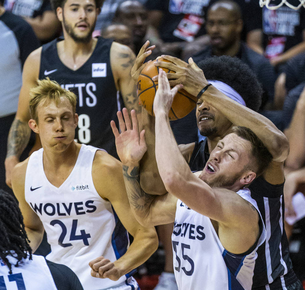 Minnesota Timberwolves forward Mitchell Creek, front right, battles for a loose ball with Brook ...