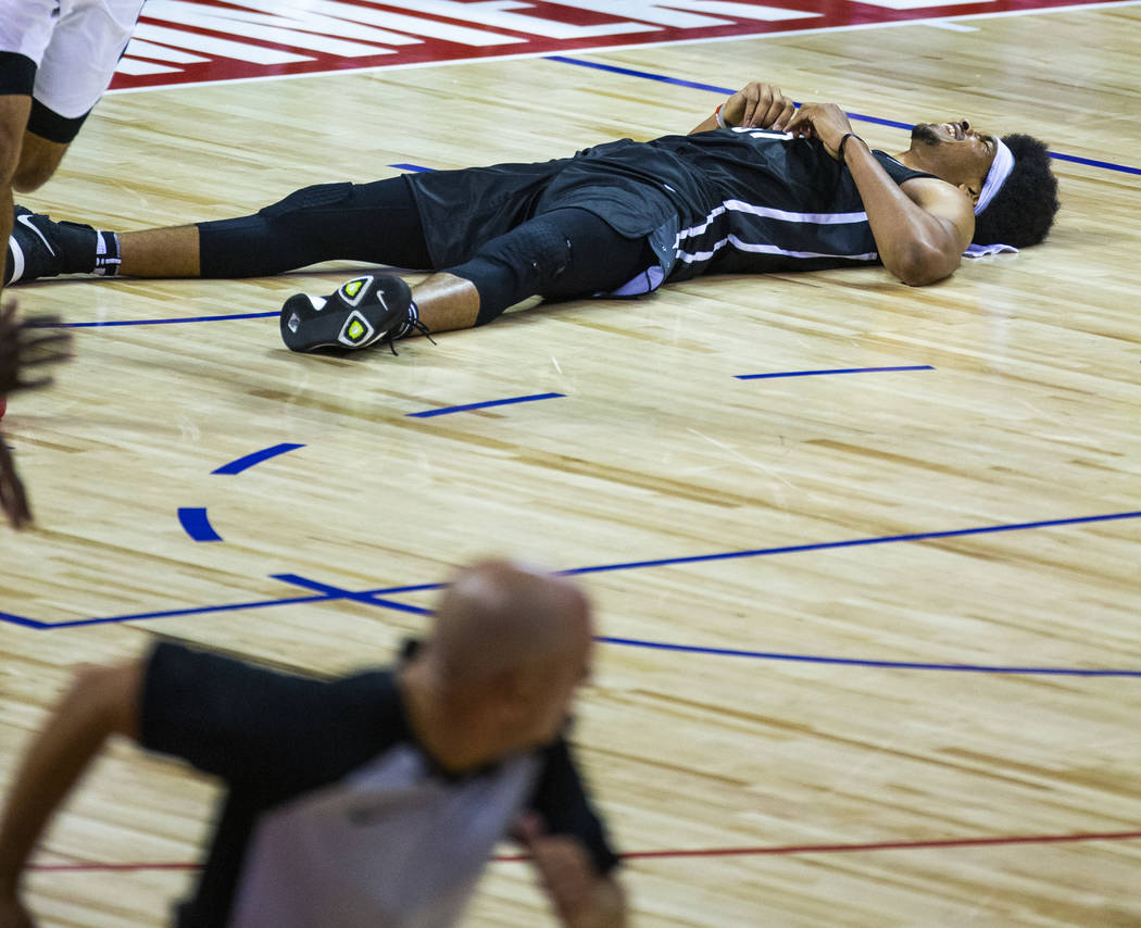Brooklyn Nets center Jarrett Allen lays on the court after a collision under the basket and har ...