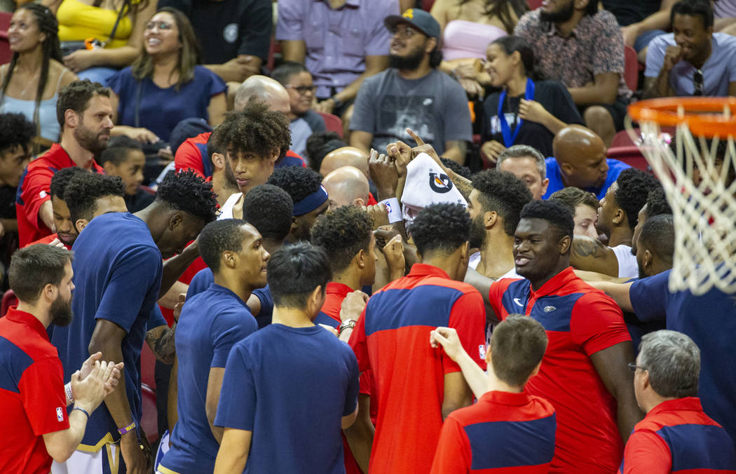 New Orleans Pelicans forward Zion Williamson, right, joins his teammates in huddle versus the M ...