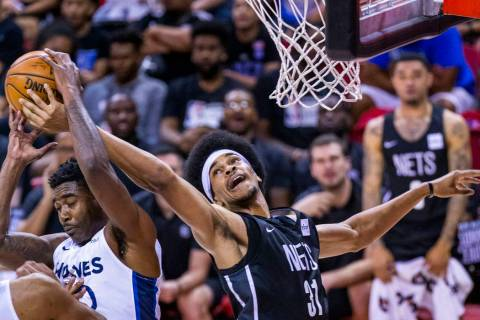 Minnesota Timberwolves forward Kelan Martin, left, has the ball ripped out my Brooklyn Nets cen ...