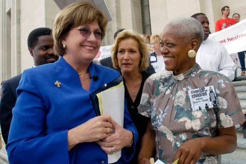 FILE - In this April 20, 2004 file photo, Rep. Carla Blanchard Dartez, D-Morgan City, center co ...