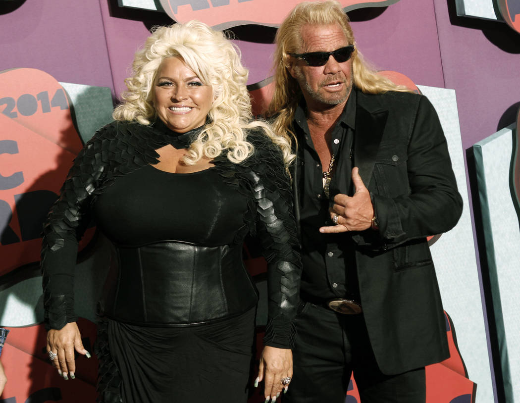 FILE - In this June 4, 2014 file photo, Beth Chapman, left, and Duane Chapman arrive at the CMT ...