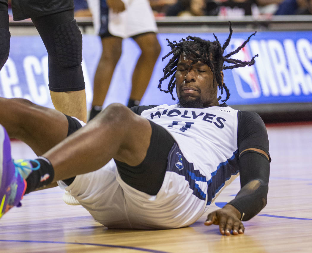 Minnesota Timberwolves center Naz Reid crashes to the court versus the Brooklyn Nets during the ...